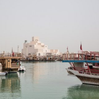 Rows of traditional wooden dhow boats in Doha Qatar