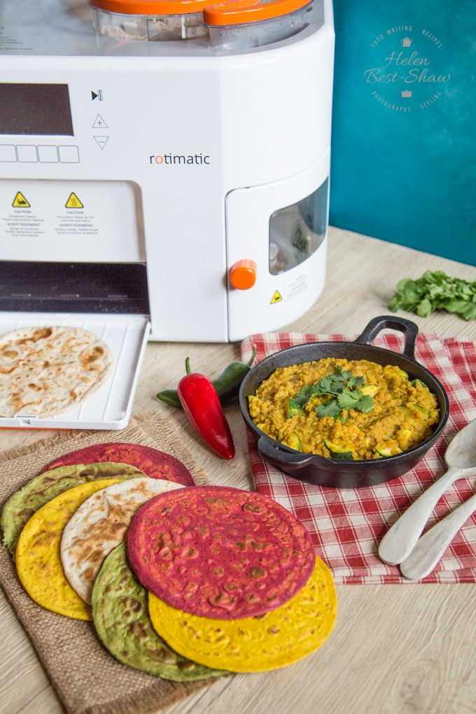 Coloured rotis in front of the rotimatic roti making machine.