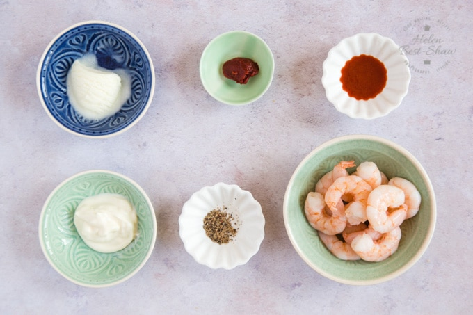 The ingredients for yoomoo prawn cocktail laid out in six bowls.