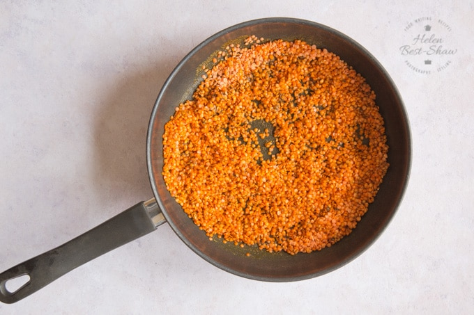 Making daal: lentils are added to fried spices, and stirred in.