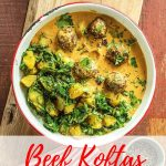 "An overhead shotof a dish of beef meatballs in a creamy golden yellow curry sauce. on the side there is a mix of spinach and potato. Text overlay reads ""Beef Koftas with Sag Aloo"""