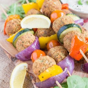 A close up of four falafel and Mediterranean vegetable kebabs
