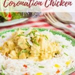 A plate of rice salad with healthy coronation chicken. i the background there are wood salad serving spoons and a plact of green salad. Text overpayreads healthy coronation chicken