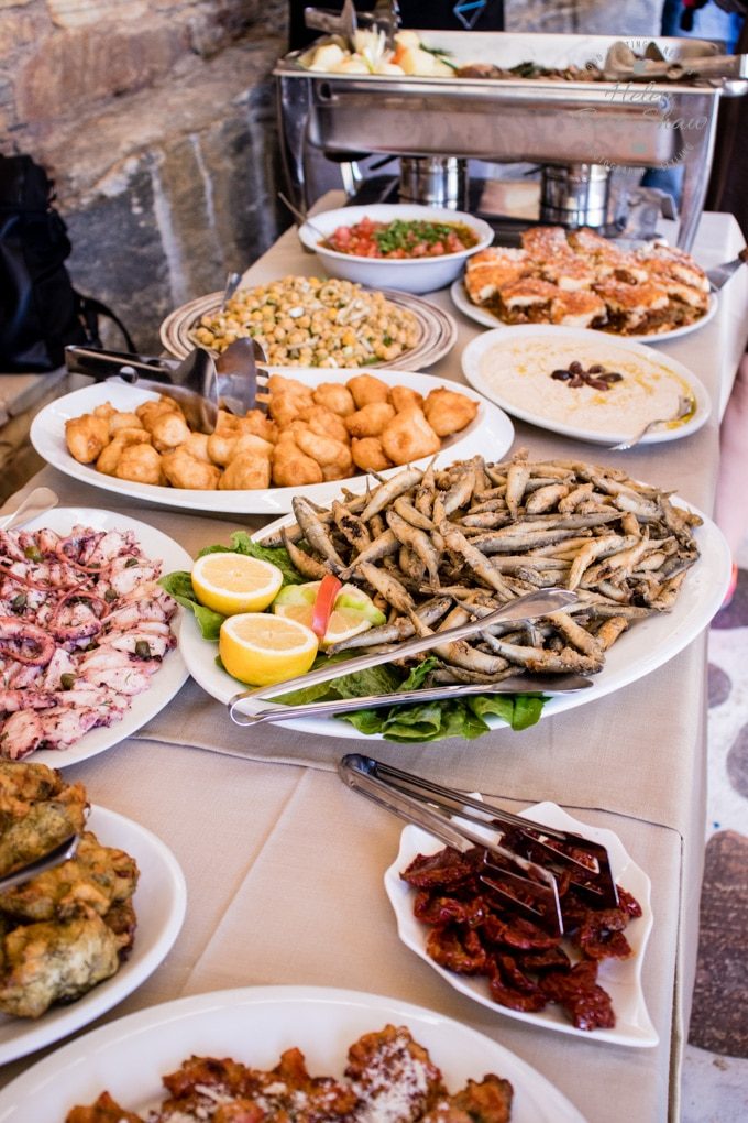 A buffet table loaded with local foods from Tinos