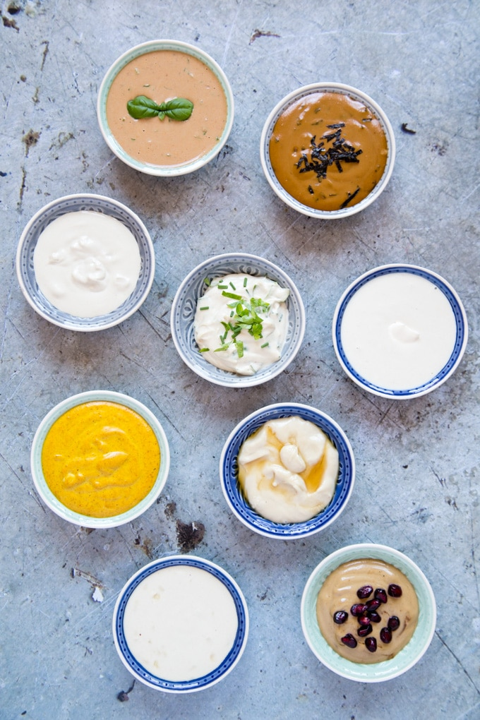 A top down view of 8 different types of tahini dressing