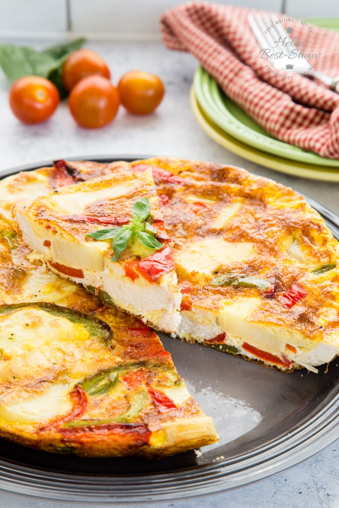 A close up of a turkey frittata made with leftover roast turkey, bell peppers and potatoes.