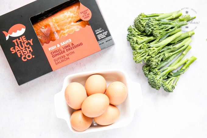 Ingredients for salmong frittata and tenderstem: eggs in a square white dish, a packet of salmon fillets and tenderstem head.