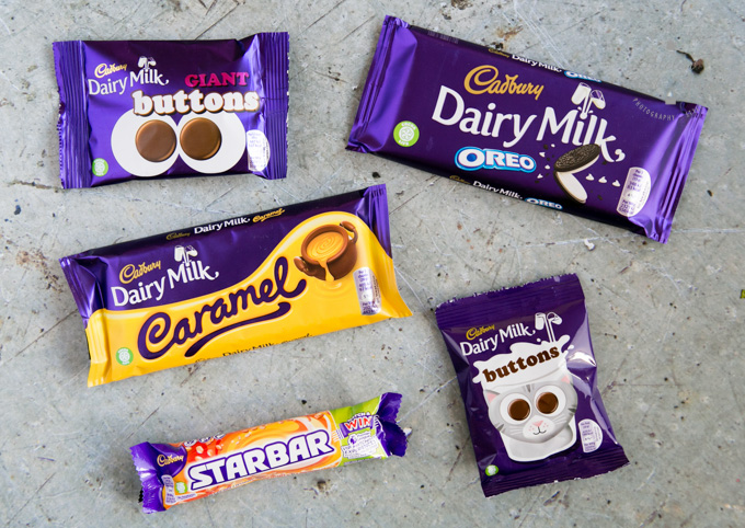 A selection of Cadbury chocolate bars with the cocoa life logo