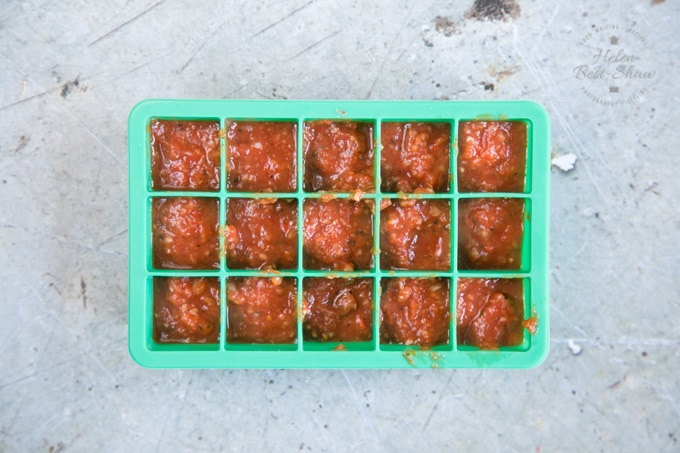 How to freeze kebab shop chilli sauce - the sauce has been measured out into a silicone ice cube tray, ready to go in the freezer.