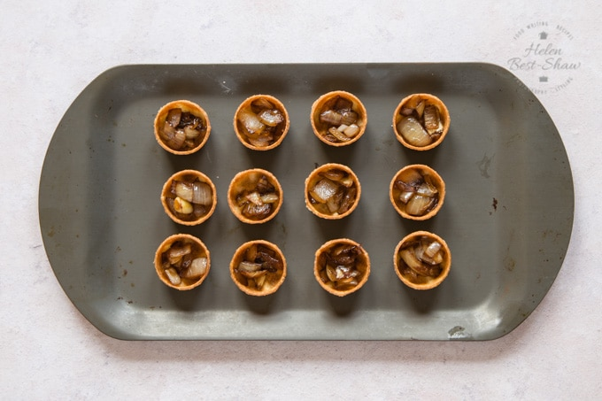 Canape shells full of slow cooked balsamic onion, for Parma Ham canapes.