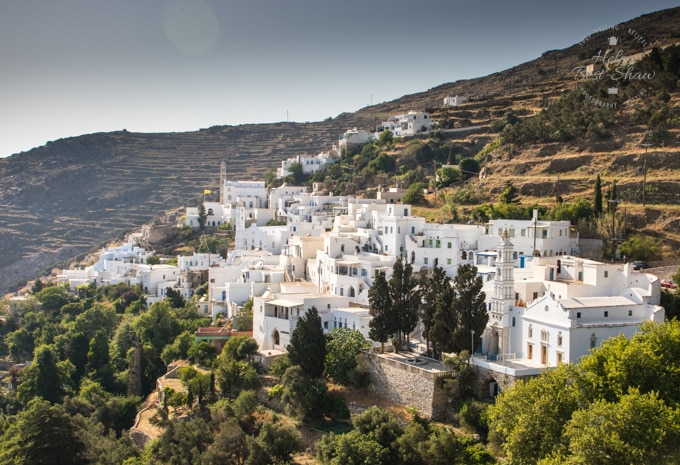 The pretty whitewashed village of Kardiani clinging to the edge of the hills in Tinos
