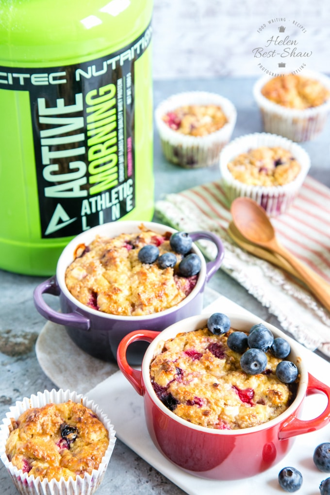 Individual ramekin dishes of breakfast protein baked oats, with a lime green container of Scitec Active Morning in the background.