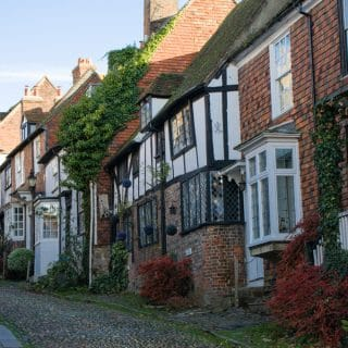Mermaid Street, Rye, East Sussex. The street is cobbled, and higgledy-piggledy houses look straight onto the street.