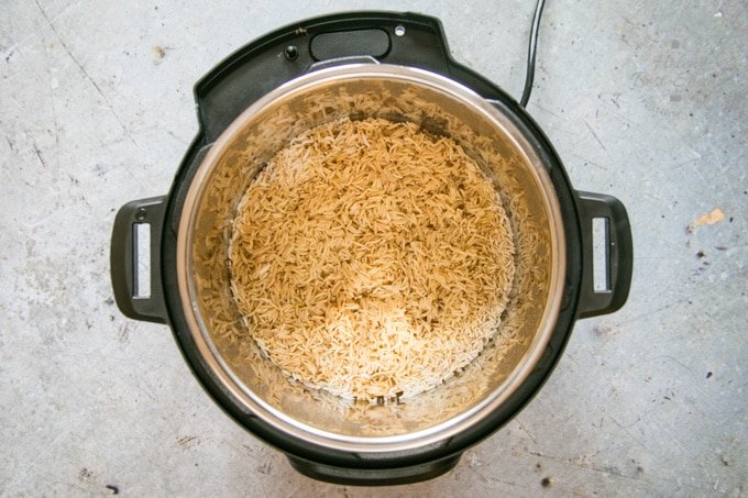 A top down shot into an Instant Pot containing cooked Chinese style rice.