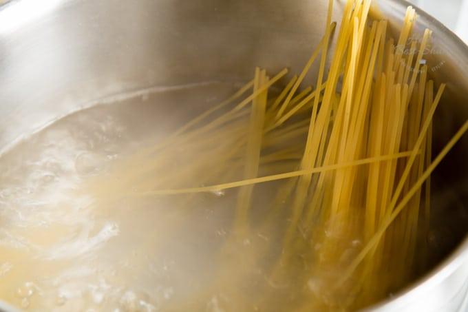 Saucepan of spaghetti cooking