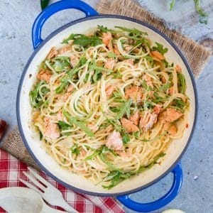 A top down picture of a dish of 10 minute creamy salmon pasta