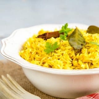 A close up of a bowl of yellow easy Instant Pot pilau rice.