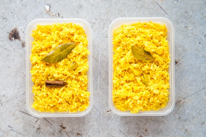 Two plastic takeaway trays filled with homemade pilau rice