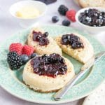 Two crumpets spread with richly flaovured dark purple mixed berry jam