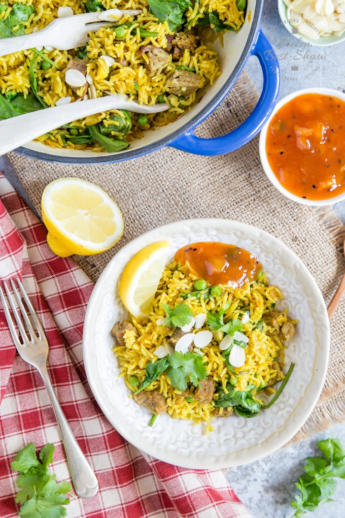A bowl of rich yellow biryani made from leftover lamb, from above.