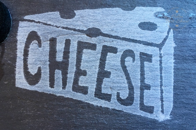 Cheese logo etched onto slate
