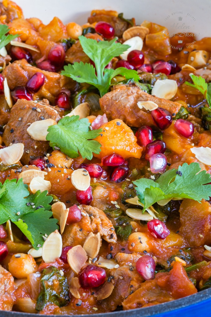 A close up of leftover lamb tagine with apricot, served with jewelled pomegranate seeds.