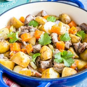 Close up on a casserole of leftover lamb stew, with potatoes and carrots.
