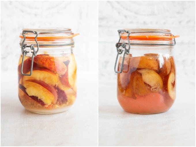 A jar of peach gin, before and after steeping. Fruit shrinks and liquid goes pink.