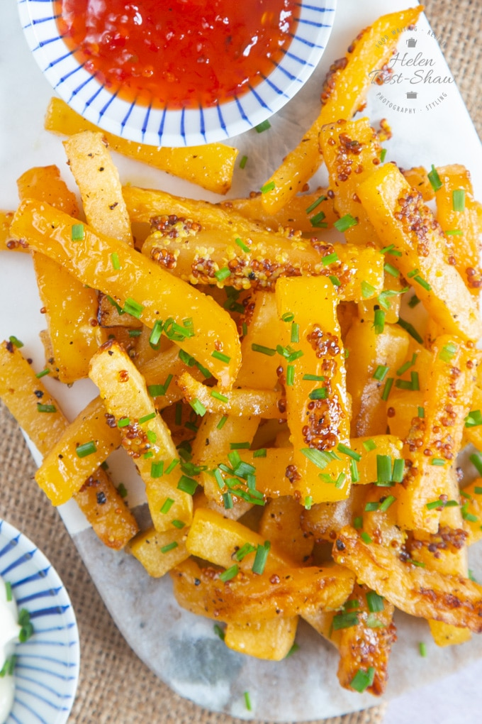 Close up picture of swede chips with honey and mustard dressing