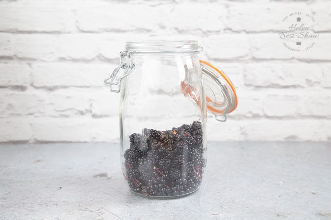 Blackberries and elderflowers in a wide mouth jar.