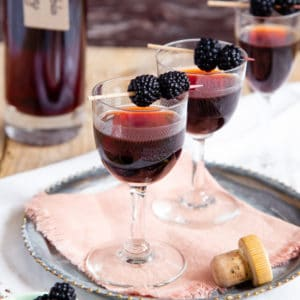 A close up of liqueur glasses of bramble whisky