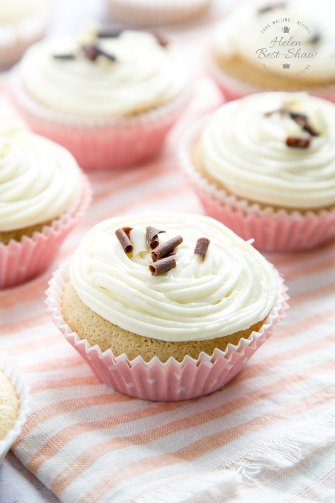 Pale egg free cupcakes with frosting and small chocolate decorations