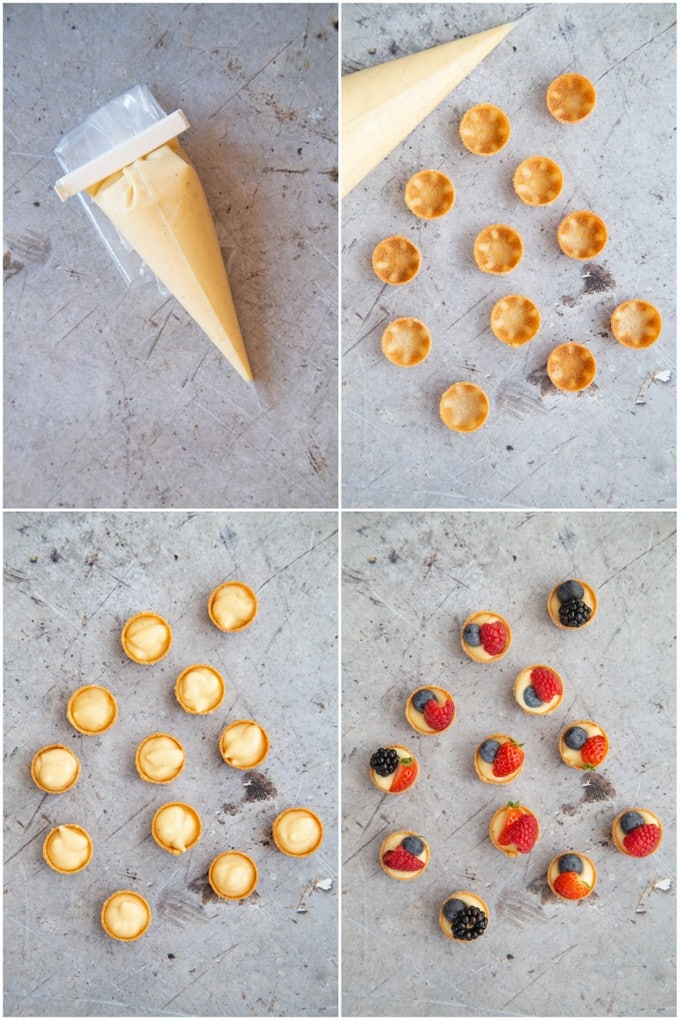 Making mini fruit tarts. Piping creme patissiere into pastry cases and adding fruit.