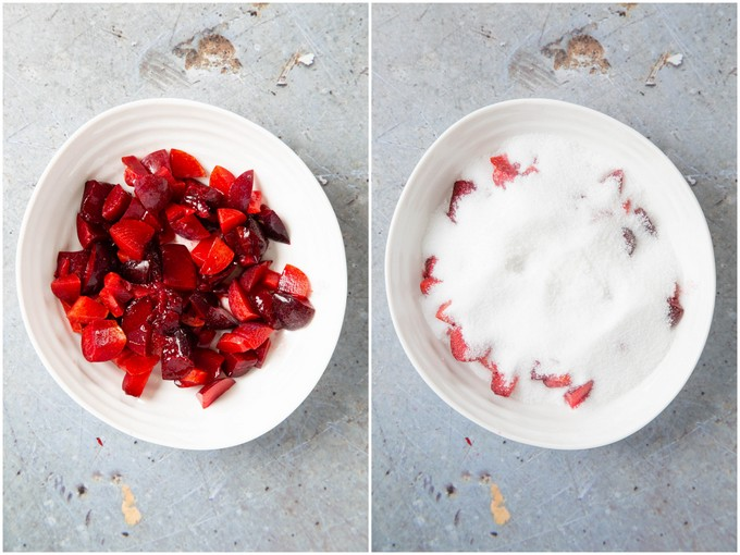 Two white bowls of plums. The first contains chopped fruit, in the second the fruit has been covered with sugar.