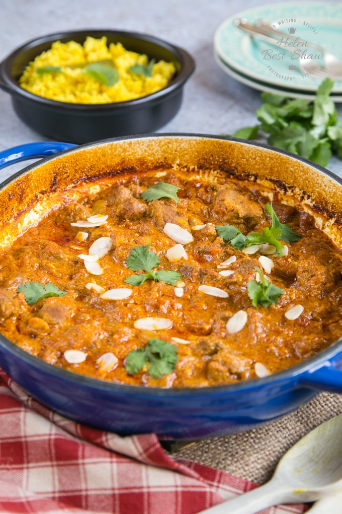 A flat casserole dish of richly coloured lamb rogan josh