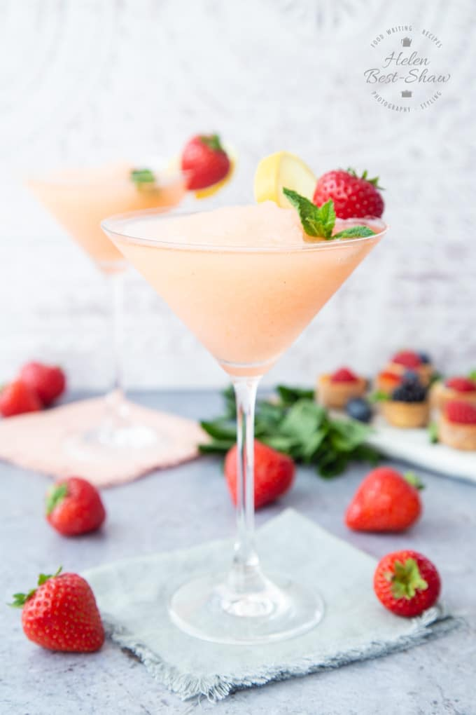 Showing the pale pink colour and frozen slushie texture of a strawberry prosecco slushie
