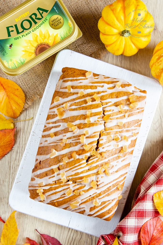 A picture from above of a sheet pumpkin spice cake with a drizzled icing topping.