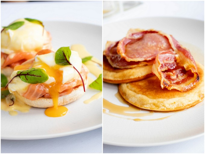 Plates of eggs royale and bacon topped pancakes
