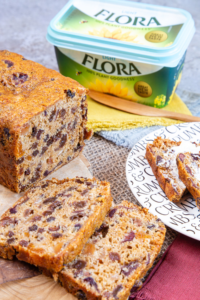 Sliced fruity loaf, with a packet of Flora Light in the background