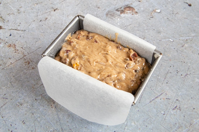 Tea loaf batter in a greased loaf tin, ready to bake.