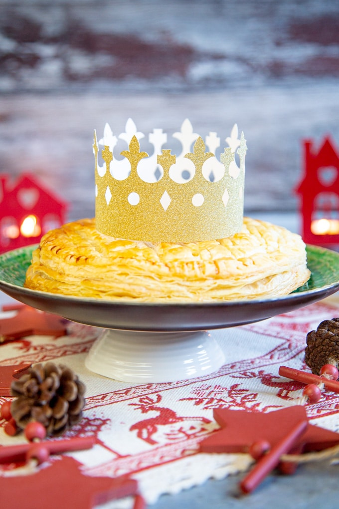 Galette des Rois with a golden card crown on top.