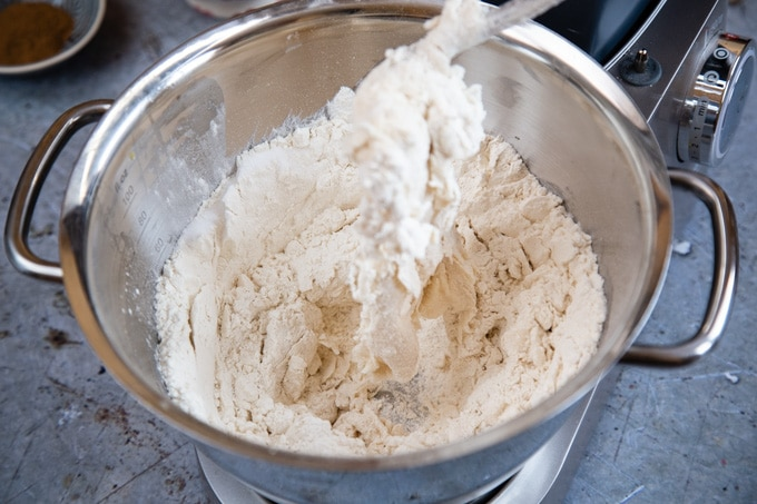 Beating in the flour to form a dough