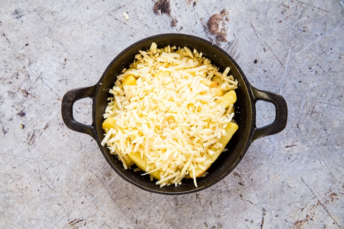 The chips are covered with grated cheese