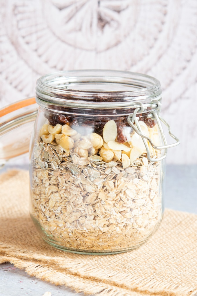 Our recipe for homemade muesli made in layers in a kilner jar, ready to be mixed.