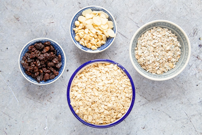 The ingredients to Alpen style muesli - oats and rye flakes, nuts, and dried fruit