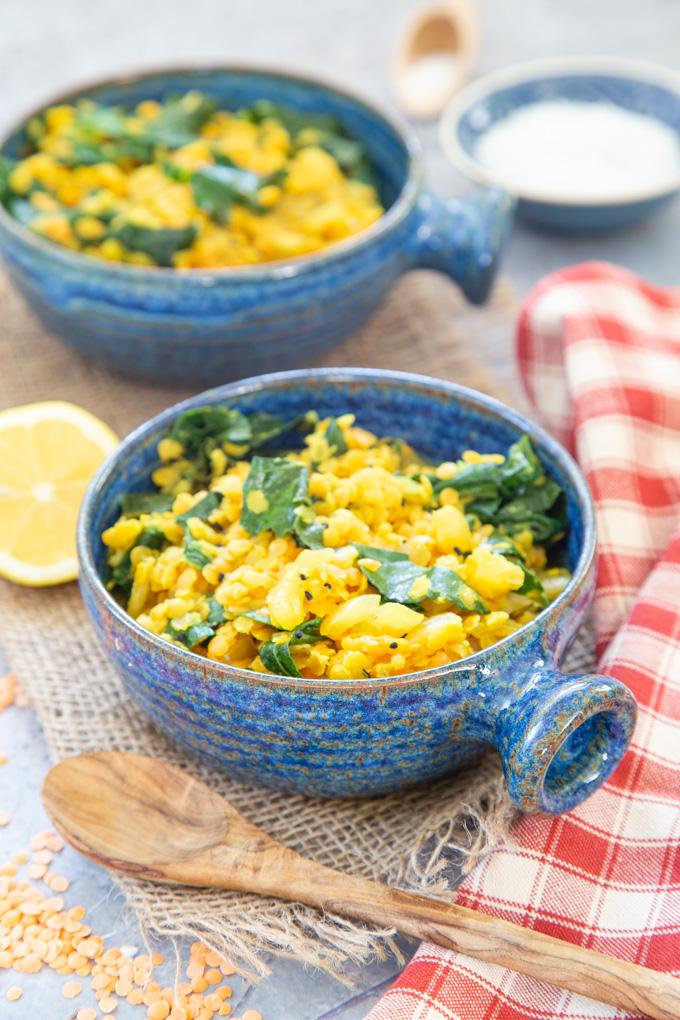 A serving of lentil dal in a blue bowl