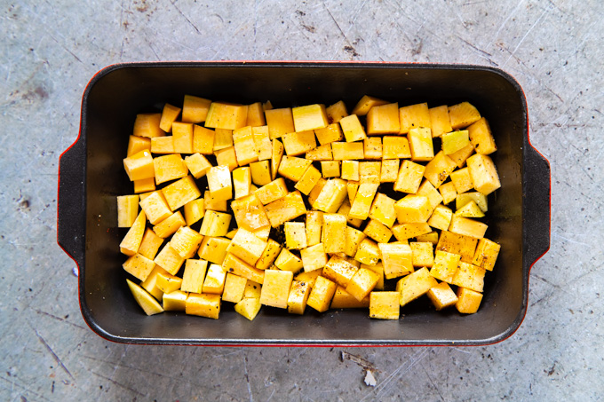 A top down view of an oven dish of swede ready to be roasted