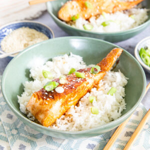 A close-up of a teriyaki salmon fillet.