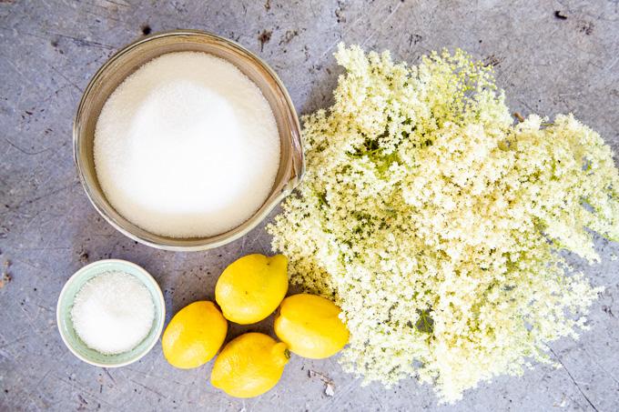 Ingredients for elderflower cordial - elder flowers, sugar, vitamin C, and lemons.