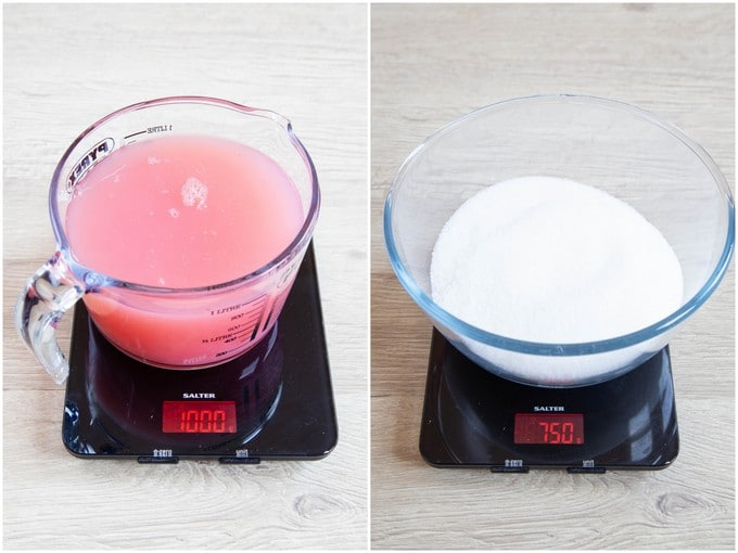 A jug of juice on scales weighing 1kg, and a 750g bowl of sugar.